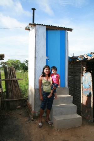 <p>Mom and son near a latrine in Bolivia. Photo by W.Oswald</p>