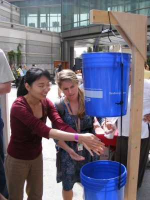 <p>Rollins students testing out a hand-washing station</p>