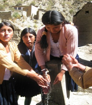 <p>Women and girls washing hands in Bolivia</p>