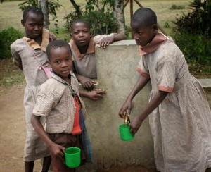 <p>School kids with getting water with cups. Photo by Matt Freeman</p>